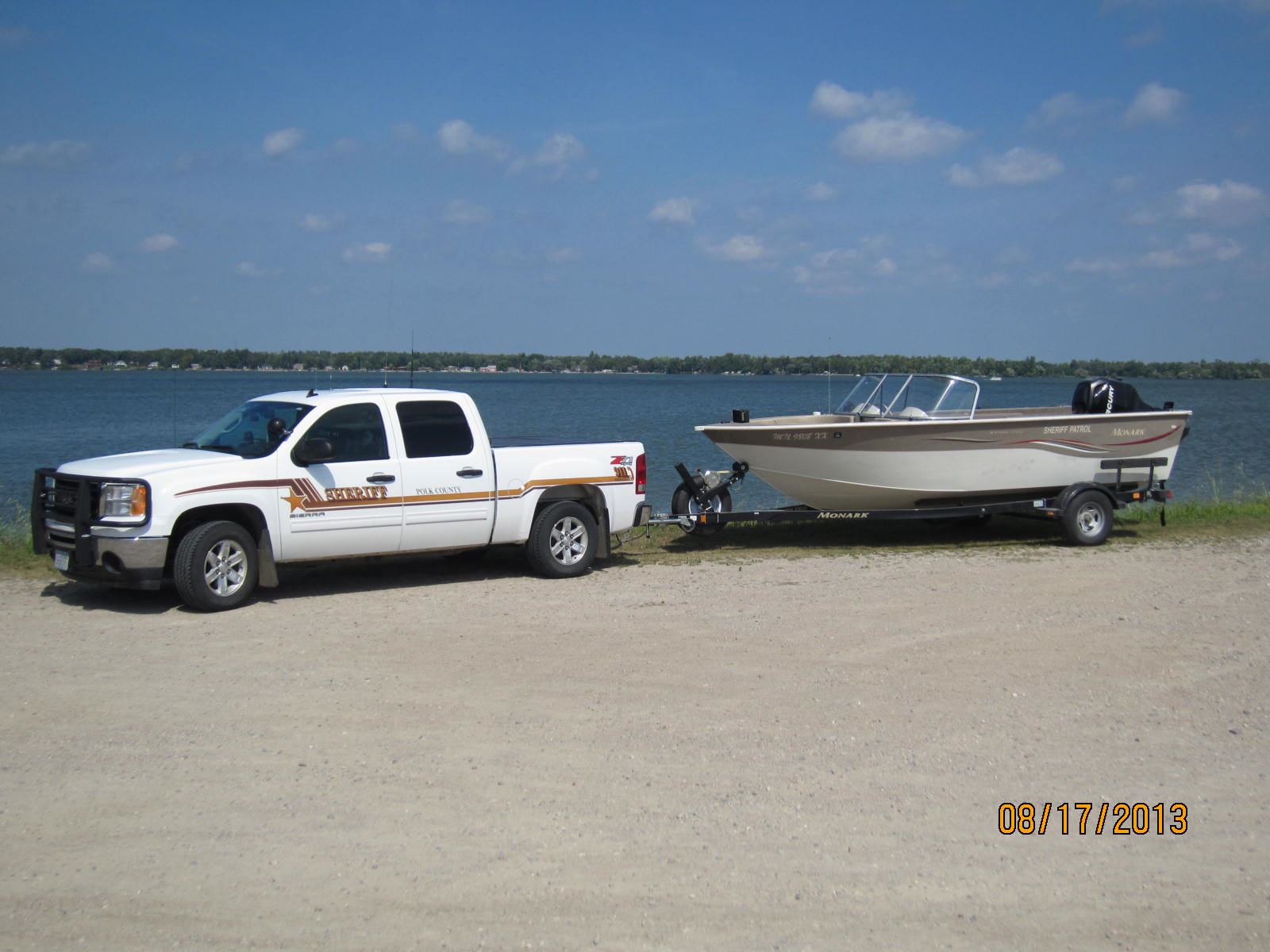 Monarch Boat pulled by Sheriff Truck